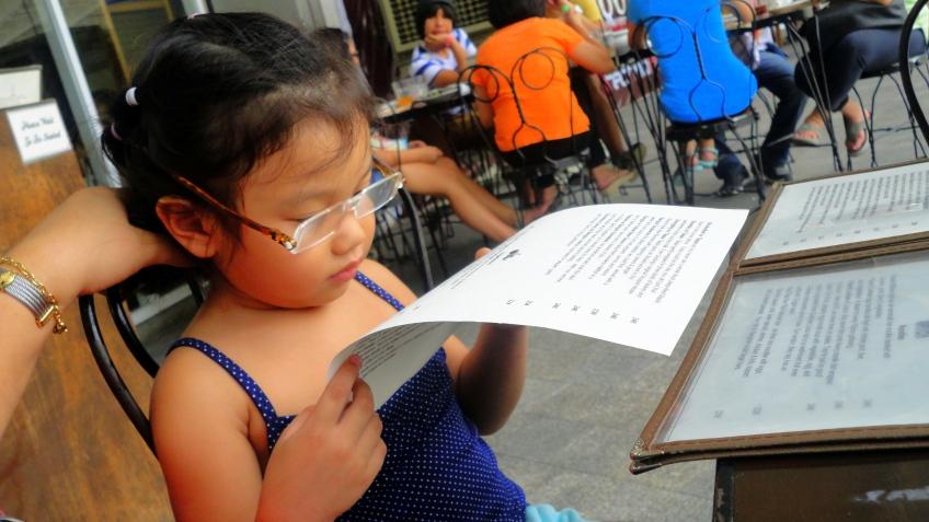 mom's reading glasses, pretending to read