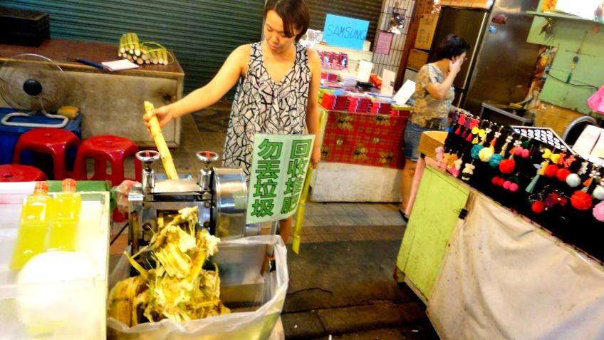 sugarcane lady, juicing the sugar cane