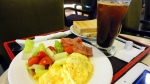 cheesy omelet, floppy bacon, and salad at Helen Coffee.  with toast and iced tea.
