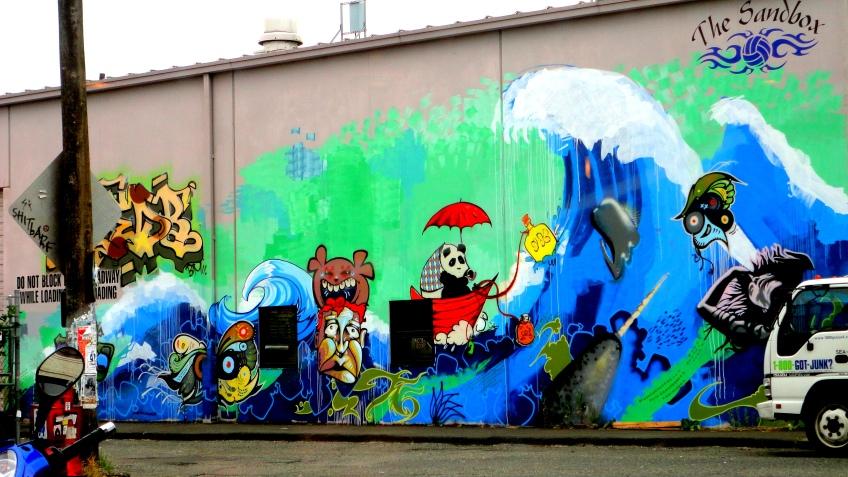 sandbox mural across from all city coffee