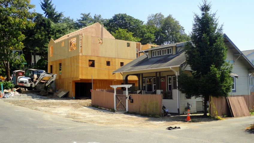 """new construction:  4 skinny houses behind the """"drug house"""" which was on a huge double lot."""