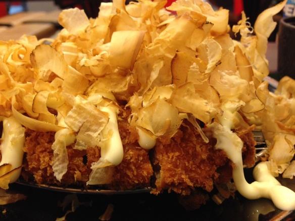 Detail:  Tonkatsu with katsuboshi (bonito flakes).