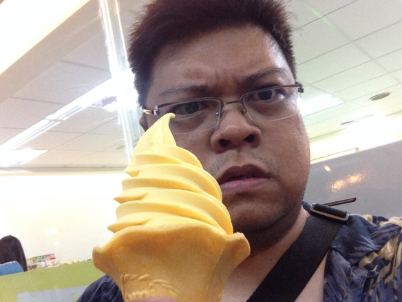 Day 4 grouchy mango soft serve selfie.  It's hot here.