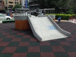 concrete playground slide equals ouch
